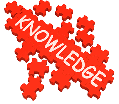 red puzzle pieces with KNOWLEDGE inscribed