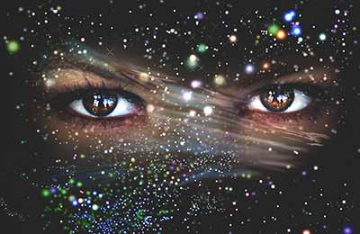 Pair of eyes superimposed on starry background
